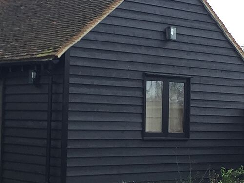 black painted external feather edge sawn timber cladding. Black Bedroom Furniture Sets. Home Design Ideas